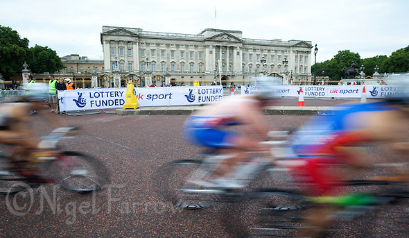 06 AUG 2011 - LONDON,GBR - Competitors cycle past Buckingham Palace during the women's round of triathlon's ITU World Championship Series (PHOTO (C) NIGEL FARROW) (NIGEL FARROW/(C) 2011 NIGEL FARROW)