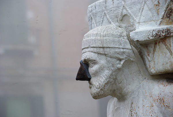 VENICE, ITALY - JANUARY 05: The face of the statue of Rioba is seen as thick fog shrouds Campo de Mori and the all the city, on January 5, 2012 in Venice, Italy. Venice woke up this morning under a heavy blanket of fog adding to the atmosphere of the city. (Marco Secchi)
