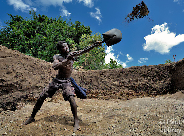 Jackson Thawalima, 45, digs out a reservoir for an irrigation system in Chisatha, a village in southern Malawi on its border with Mozambique. This village has been hard hit by drought in recent years, leading to chronic food insecurity, especially during the