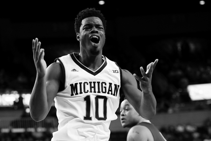 Nov 13, 2015; Ann Arbor, MI, USA; Michigan Wolverines guard Derrick Walton Jr. (10) reacts against Northern Michigan Wildcats at Crisler Center. Mandatory Credit: Rick Osentoski-USA TODAY Sports (Rick Osentoski/Rick Osentoski-USA TODAY Sports)