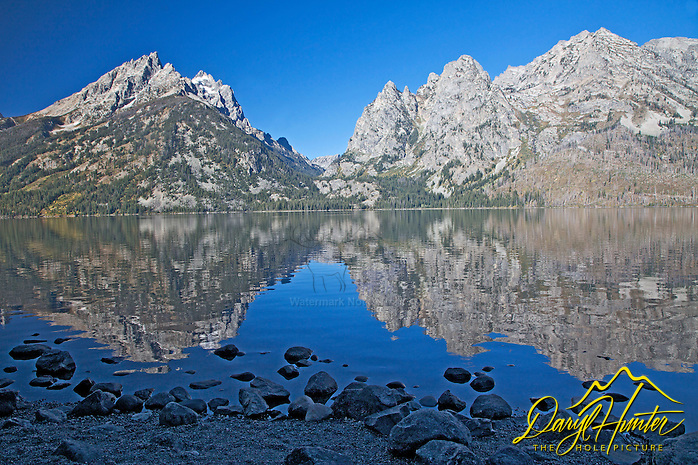 Jenny Lake Reflect the Grand Tetons. Jenny is one of the Glacial Moraine Lakes that line the foot of the Grand Tetons in Grand Teton National Park. (© Daryl L. Hunter - The Hole Picture/Daryl L. Hunter)