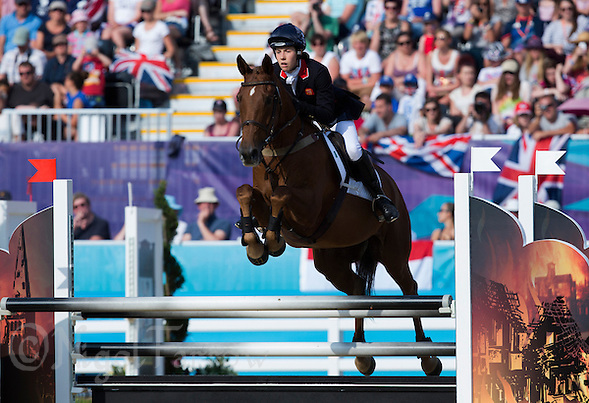 12 AUG 2012 - LONDON, GBR - Samantha Murray (GBR) of Great Britain on Glen Gold attempts to clear a fence during the women's London 2012 Olympic Games Modern Pentathlon riding in Greenwich Park, Greenwich, London, Great Britain .(PHOTO (C) 2012 NIGEL FARROW) (NIGEL FARROW/(C) 2012 NIGEL FARROW)