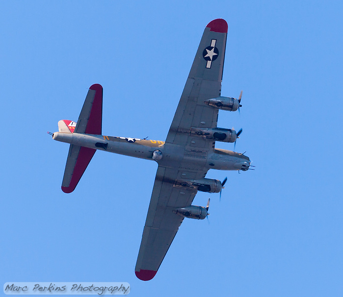 "The B-17 ""Flying Fortress"" bomber ""Nine-Oh-Nine"", tail number 231909, flying over Orange County, CA on May 12, 2013.  Taken about an hour before sunset, the bottom is clearly visible and evenly lit.  The vintage plane has been resored by The Collins Foundation to it's WWII (World War 2) configuration, after having served in nuclear bomb testing in the 1950's, being sold as scrap, and being converted into a forest-fire supression plane. (Marc C. Perkins)"