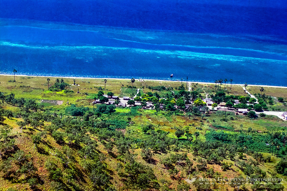 Maluku, South East Maluku, Pulau Liran. A small village on the southwest tip of Pulau Liran (from helicopter). (Photo Bjorn Grotting)