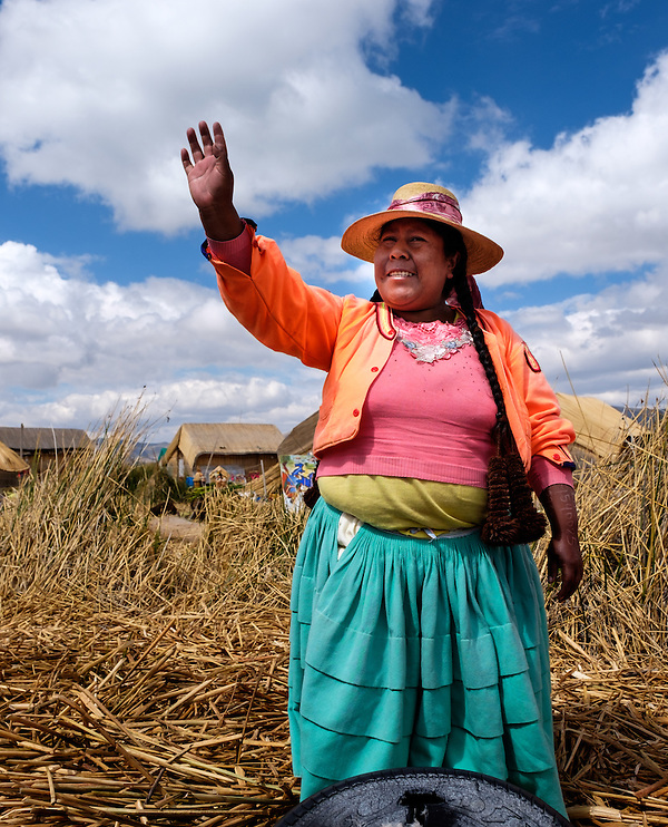 UROS ISLANDS, PERU - CIRCA October 2015: Woman from the Uros waving hands and welcoming people in the floating Islands of Lake Titicaca. (Daniel Korzeniewski)