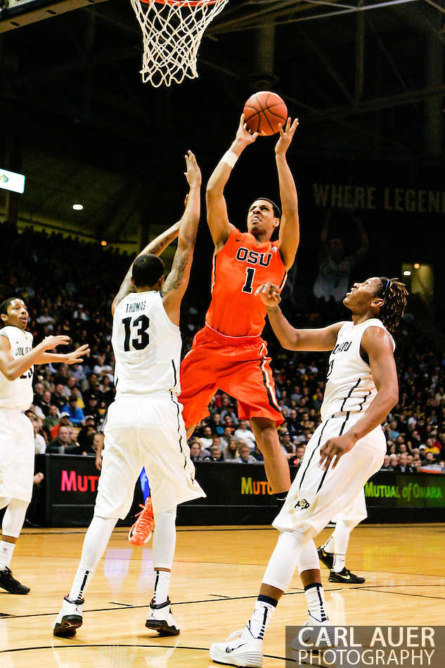 January 2nd, 2014:  Oregon State Beavers sophomore guard/forward Victor Robbins (1) shoots the ball over Colorado Buffaloes freshman forward Dustin Thomas (13) and sophomore forward Xavier Johnson (2)in first half action of the NCAA Basketball game between the Oregon State Beavers and the University of Colorado Buffaloes at the Coors Events Center in Boulder, Colorado (Carl Auer/ZUMAPRESS.com)