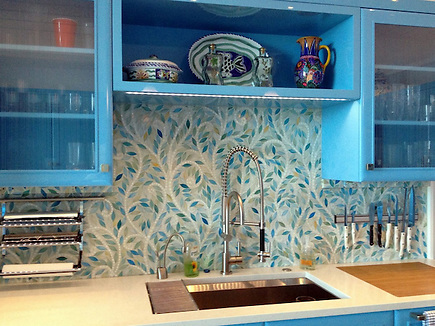 Climbing Vine, a jewel glass mosaic backsplash, is shown in Quartz and Aquamarine glass. (New Ravenna Mosaics 2011)