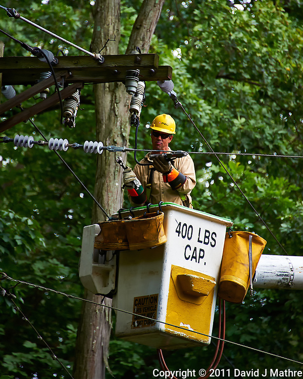 PSE&G Lineman Repairing the Power Line to My House after Huricane Irene Hit New Jersey. Image taken with a Nikon D700 and 28-300 mm VR lens (ISO 450, 300 mm, f/5.6, 1/125 sec). (David J Mathre)