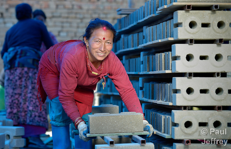 Kanchi Shrestha stacks blocks that she and other villagers in Sanogoan, Nepal, will use to build their new homes. This Newar community was hard hit by the April 2015 earthquake that ravaged Nepal, losing almost all their housing, but they've been helped by the ACT Alliance to rebuild their lives. The ACT Alliance has provided a variety of services here since the quake, including blankets, tents, and livelihood assistance, and is helping villagers form the tens of thousands of cement blocks they will need to construct permanent housing. (Paul Jeffrey)