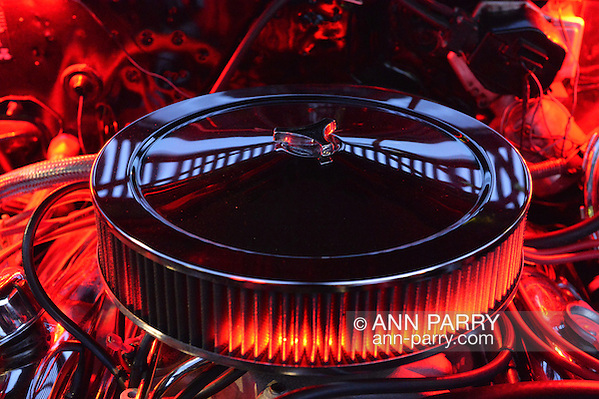 Bellmore, New York, USA. 12th June 2015. Under an open hood, the engine of a red 1972 Pontiac Convertible LeMans Sport is lit up in red at the Friday Night Car Show held at the Bellmore Long Island Railroad Station Parking Lot. Hundreds of classic, antique, and custom cars were on view at the free weekly show, sponsored by the Chamber of Commerce of the Bellmores. (Ann Parry/Ann Parry, ann-parry.com)