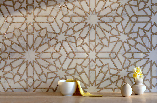 Castilla, a natural stone waterjet and hand cut mosaic shown in Jura Grey honed and Calacatta Tia polished, is part of the Miraflores Collection by Paul Schatz for New Ravenna Mosaics. (Picasa)