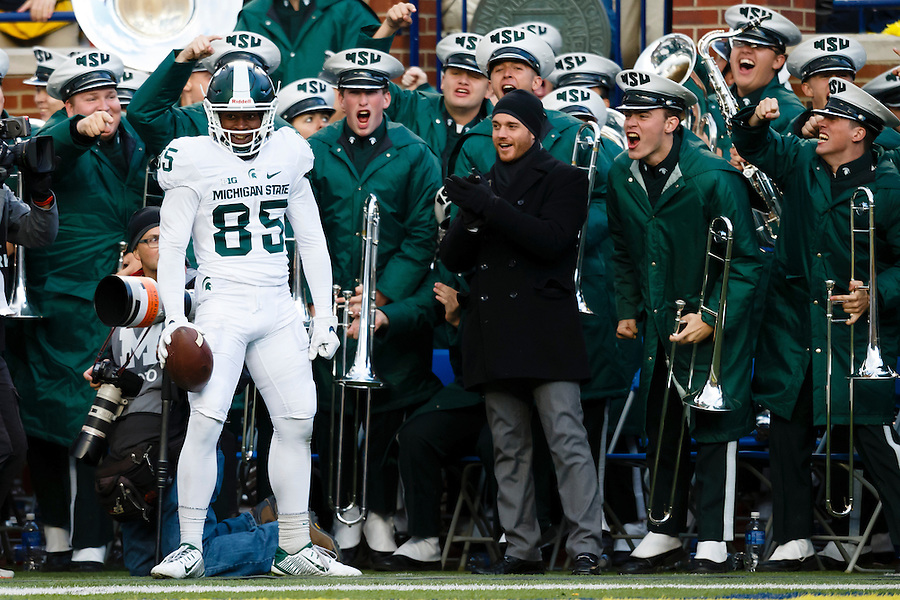 Oct 17, 2015; Ann Arbor, MI, USA; Michigan State Spartans wide receiver Macgarrett Kings Jr. (85) celebrates touchdown in the third quarter against the Michigan Wolverines at Michigan Stadium. Mandatory Credit: Rick Osentoski-USA TODAY Sports (Rick Osentoski/Rick Osentoski-USA TODAY Sports)