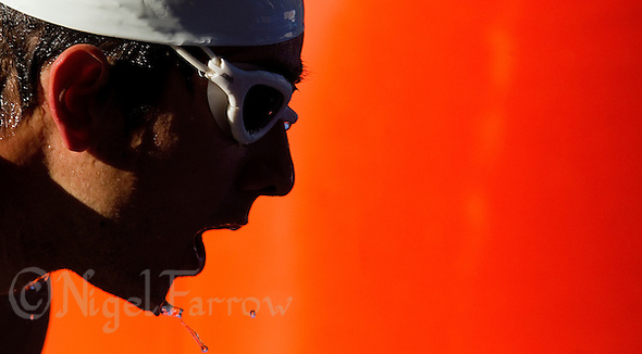 27 MAY 2012 - MADRID, ESP - A competitor leaves the water at the end of the swim at the Spanish Elite Men's National Sprint Distance Championship qualifying race at Casa de Campo in Madrid, Spain (PHOTO (C) 2012 NIGEL FARROW) (NIGEL FARROW/(C) 2012 NIGEL FARROW)
