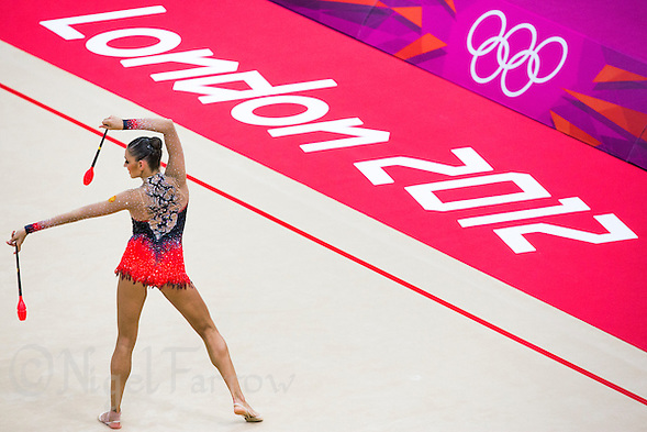 11 AUG 2012 - LONDON, GBR - Evgeniya Kanaeva (RUS) of Russia performs her club routine during the 2012 London Olympic Games Individual All-Around Rhythmic Gymnastics final at Wembley Arena in London, Great Britain (PHOTO (C) 2012 NIGEL FARROW) (NIGEL FARROW/(C) 2012 NIGEL FARROW)