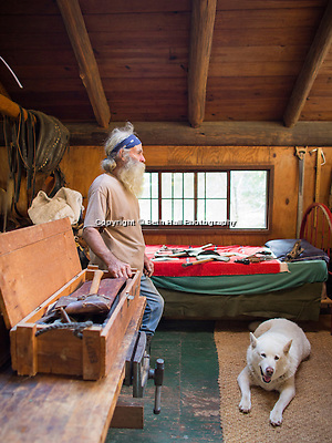 Robert Runyon looks through a box of antique hand tools at his home in Sugar Tree Hollow in Winslow, Arkansas, for Out Here Magazine. Photo by Beth Hall (Beth Hall)