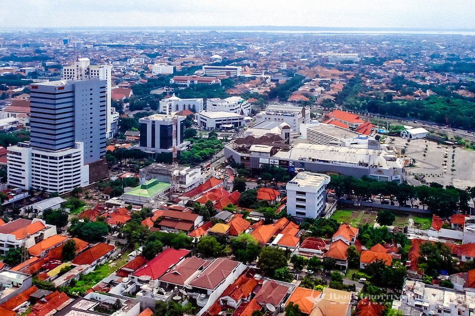 Java, East Java, Surabaya. View over Surabaya center. Surabaya Mall center front of image.  Madura in the background (from helicopter). (Bjorn Grotting)