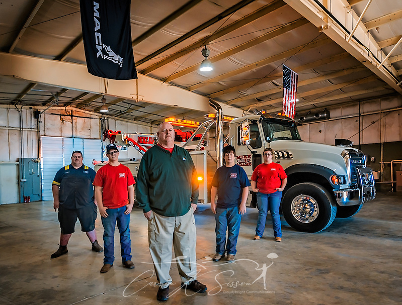 Mike Adams, of Mike Adams Towing and Air Cushion Recovery, poses with his children beside his newest truck, a 2016 Mack Granite with a 50-ton Century rotator, March 22, 2016, in Macon, Georgia. Adams is teaching the children about the business so that they can someday take over. From left are, Lane Adams, Matthew Adams, Mike Adams, Mack Adams and Megan Adams. (Photo by Carmen K. Sisson/Cloudybright) (Carmen K. Sisson/Cloudybright)
