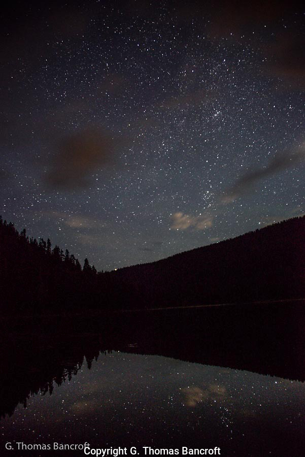 Thousands of stars were visible above Lake Janus and reflected in the mirror flat water.  It was an inspiring and invigorating sight.  I stood watching for a long time in awe. (G. Thomas Bancroft)