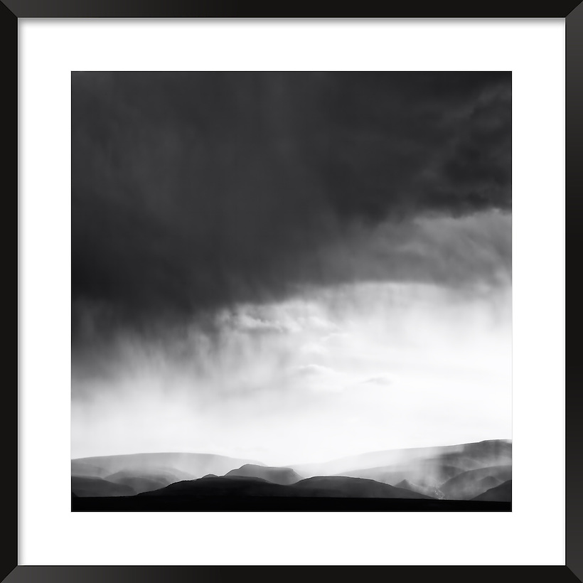 Dark clouds and rain with mountains in Morocco. Fine art black&white image. (Rosa Frei)