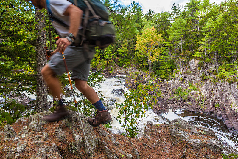 A man hikes the International Appalachian Trail east of Baxter State Park in Maine's northern forest. Near Grand Pitch on the East Branch of the Penobscot River. (Jerry and Marcy Monkman)