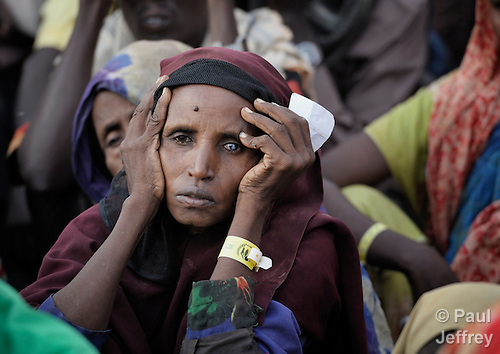 A newly arrived Somali woman waits in line for food to be distributed at the reception center of the Dagahaley refugee camp, part of the Dadaab refugee complex in northeastern Kenya.