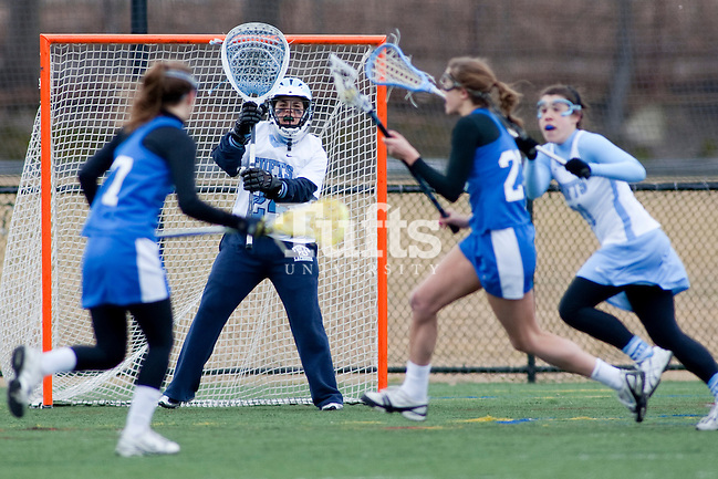 03/10/2012- Medford, Mass. - Tufts goalkeeper Tess Shapanka, A13, tracks a Hamilton ball carrier in Tufts 8-7 season opening win over Hamilton on Mar. 10, 2012. (Kelvin Ma/Tufts University)