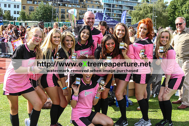 London, UK on Sunday 31st August, 2014. PowPow girl's team with Lucy Kay and Anais Gallagher during the Soccer Six charity celebrity football tournament at Mile End Stadium, London. (David Horn/EAP)