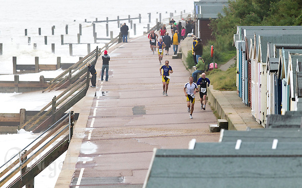 26 SEP 2010 - CLACTON, GBR - Competitors make their way along the promenade during the Clacton Standard Distance Triathlon (PHOTO (C) NIGEL FARROW) (NIGEL FARROW/(C) 2010 NIGEL FARROW)