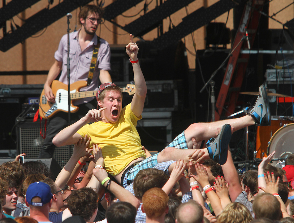 Ian Ray of Cedar Rapids crowd surfs while Titus Andronicus plays to the crowd during the 80/35 Music Festival at Western Gateway Park July 2 in Des Moines. (Christopher Gannon/The Register)
