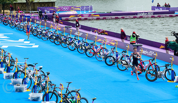 07 AUG 2012 - LONDON, GBR - Alistair Brownlee (GBR) of Great Britain (right) leads Javier Gomez (ESP) of Spain (left) through transition for the start of the fourth run lap during the men's London 2012 Olympic Games Triathlon in Hyde Park, London, Great Britain (PHOTO (C) 2012 NIGEL FARROW) (NIGEL FARROW/(C) 2012 NIGEL FARROW)
