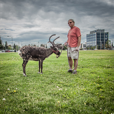 "David Hall with Star the Reindeer on the Delaney Park Strip in downtown Anchorage.  ""I've been friends with Star for 11 years.  I love to take her for walks.""  -David Hall  david_of_the_lake@hotmail.com (© Clark James Mishler)"