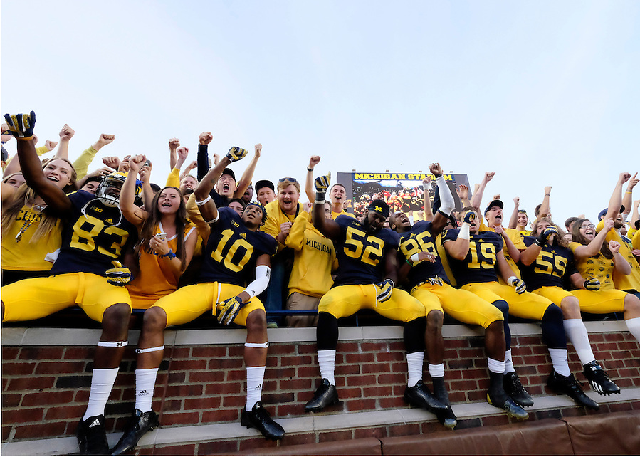 Oct 10, 2015; Ann Arbor, MI, USA; Michigan Wolverines players celebrate in the student section after the game against the Northwestern Wildcats at Michigan Stadium. Michigan won 38-0. Mandatory Credit: Rick Osentoski-USA TODAY Sports (Rick Osentoski/Rick Osentoski-USA TODAY Sports)