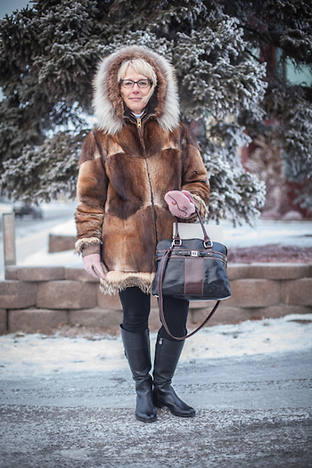 "Non-profit director Sue Brogan in Anchorage's South Addition neighborhood.  ""This parka is 30 years old…I can only bring her out when it's cold.""  sabrogan57@gmail.com (© Clark James Mishler)"