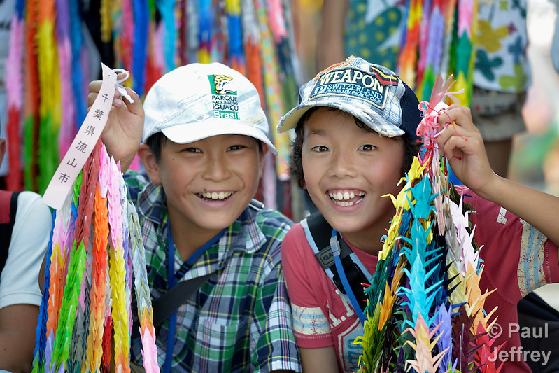 Japanese school children display folded paper cranes they have brought to Hiroshima in commemoration of the 70th anniversary of the U.S. dropping an atomic bomb on the Japanese city of Hiroshima. The cranes are a sign of hope and peace. (Paul Jeffrey)