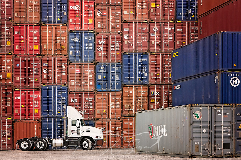 A 2018 Mack Pinnacle parks in front of a stack of storage containers at Intermodal Cartage Company, March 9, 2017, in Memphis, Tenn. ICMG, which specializes in container drayage. (Carmen K. Sisson/Cloudybright)