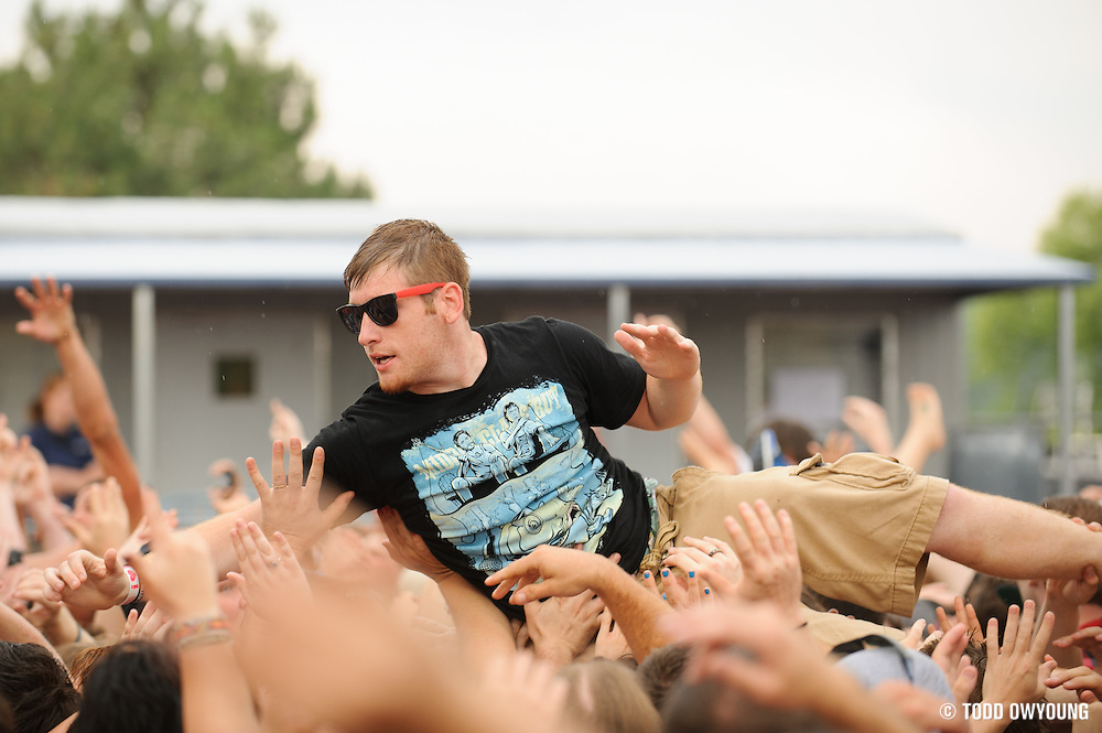 Crowdsurfers at Pointfest 30 at Verizon Wireless Amphitheater in St. Louis on May 20, 2012. (TODD OWYOUNG)