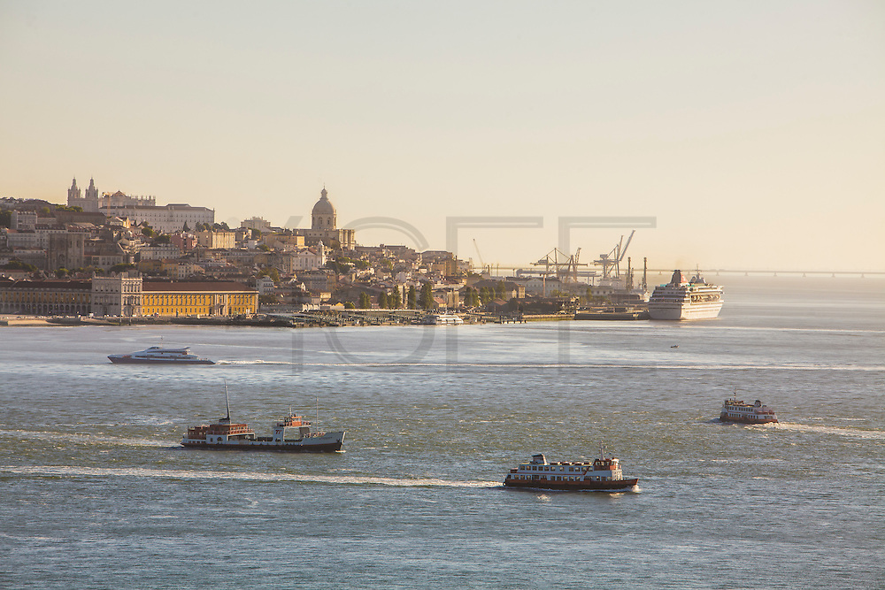 "Lisbon panorama seen from the south bank of Tagus river, in Almada. On the foreground tipical ""cacilheiro"" ships cross the river. At the distance a cruise ship is docked at the cruise terminal. (Luis Filipe Catarino/4SEE)"