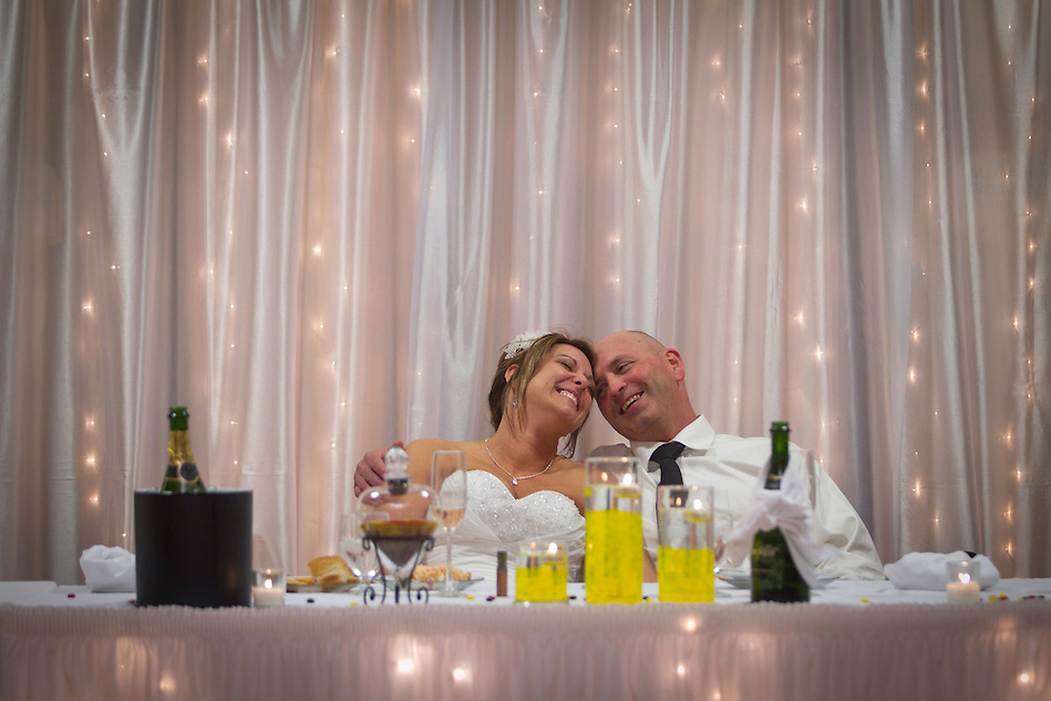 Heather Jacobs and Dan Moen share a joyous moment relaxing at their wedding reception on April 16.  More than five yeas after losing her first husband in a 2006 plane crash, Heather followed her late husband's wishes and remarried. (Christopher Gannon)