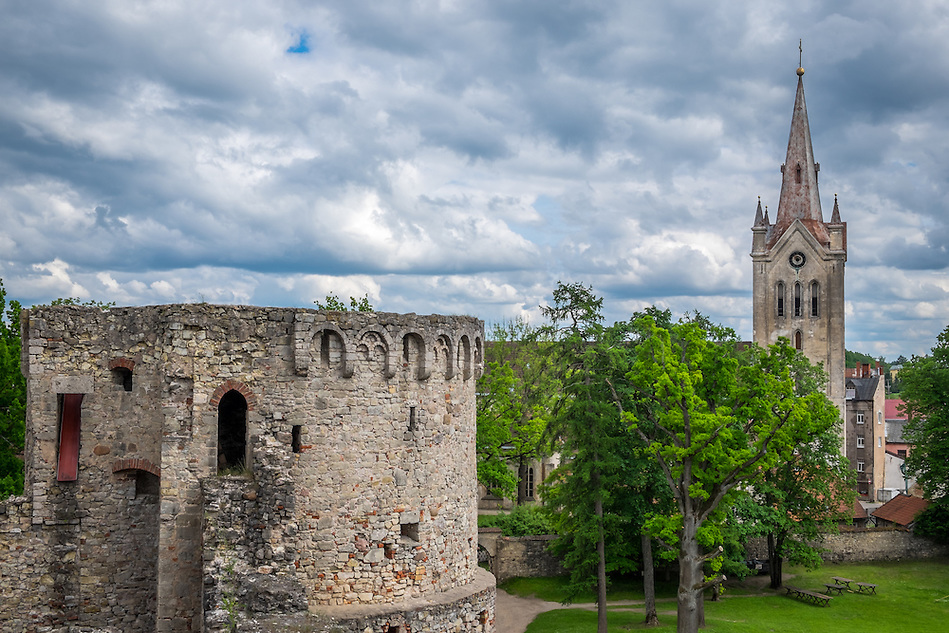 LATVIA, CESIS - CIRCA JUNE 2014: View of tower of the Cesis Castle, (Wenden) and  the St. John's Church in Latvia. (Daniel Korzeniewski)