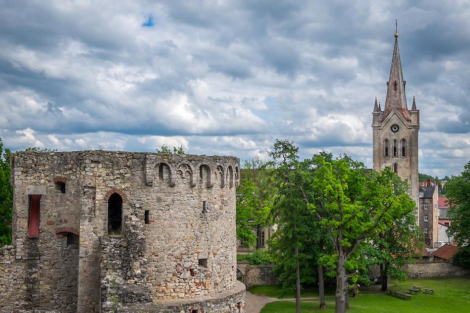 LATVIA, CESIS - CIRCA JUNE 2014: View of tower of the Cesis Castle, (Wenden) and  the St. John's Church in Latvia. (Daniel Korzeniewski)