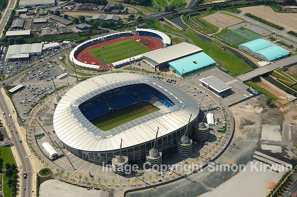 Football grounds from the air. Football grounds from the air. Aerial view of Etihad Stadium, City of Manchester Stadium, home of Manchester City FC. Aerial photography by Simon Kirwan