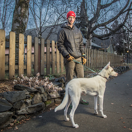 Phamacist Brian Havilarnd and his dog, Lola, on H Street in Anchorage's South Addition neighborhood (Clark James Mishler)