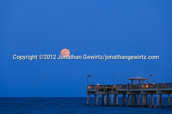 The full moon rises over the public fishing pier at Dania Beach, Florida. (&copy; 2012 Jonathan Gewirtz / jonathan@gewirtz.net)
