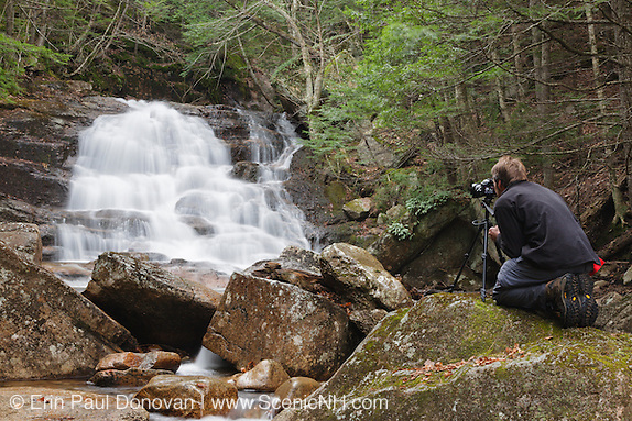 A photographer using a tripod at Ellen's Falls. Ellen's Falls are located on Hobbs Brook in Albany, New Hampshire.