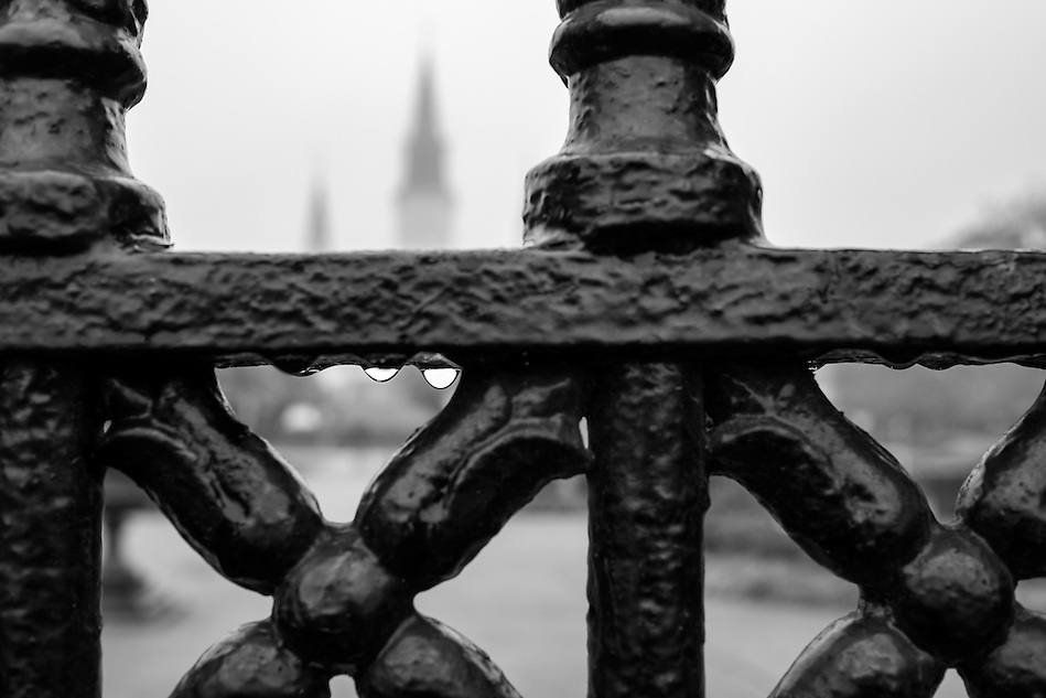 Close up of iron fence around Jackson Square in New Orleans with the St. Louis Cathedral behind. (Daniel Korzeniewski)