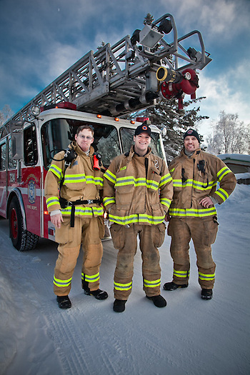 Anchorage firemen from firehouse #1, Rick Erickson, Ryan Staten, and Ryan Upchurch, on Hidden Lane, South Addition, Anchorage. (Clark James Mishler)