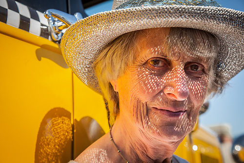 """Ingrid Woodard sits on the running board of her husbands 1920 Ford Taxi Cab at the """"Show and Shine"""" Classic Car Show on the Delaney Park Stirp in Anchorage  daledryden@gci.net (© Clark James Mishler)"""