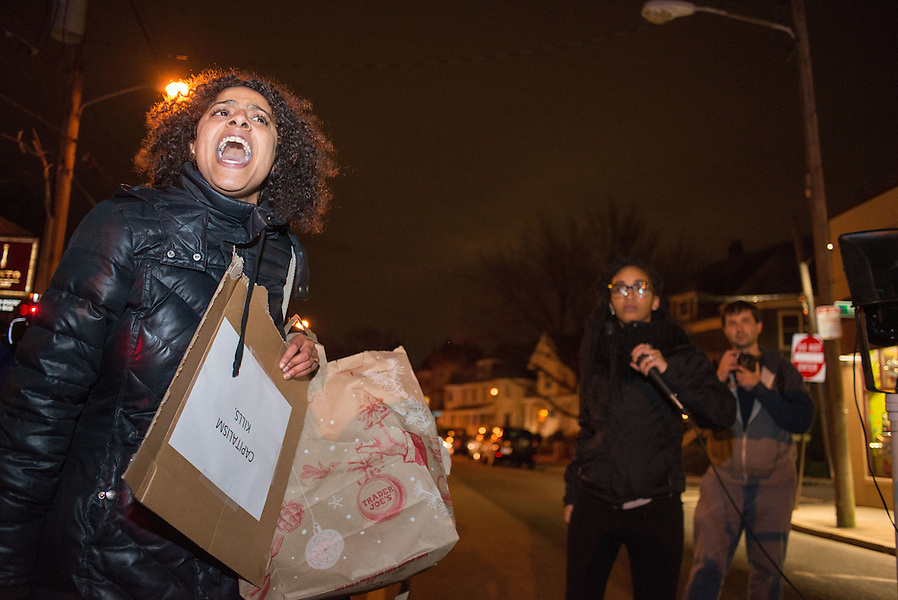 12/5/14 – Somerville, MA – Felicia Bishop, an Arlington resident, addresses the crowd during the Davis Square March which went from Tufts University, through Davis Square, and down through Cambridge to the Harvard Bridge on December 5th, 2014. (Nicholas Pfosi / The Tufts Daily) (Nicholas Pfosi / The Tufts Daily)