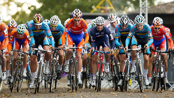 03 NOV 2012 - IPSWICH, GBR - Mike Teunissen (NED) (centre left in orange and blue ) of the Netherlands and Julian Alaphilippe (FRA) (centre right) of France find themselves surrounded by their Belgian rivals at the start of the Under 23 Men&#039;s European Cyclo-Cross Championships in Chantry Park, Ipswich, Suffolk, Great Britain (PHOTO (C) 2012 NIGEL FARROW) (NIGEL FARROW/(C) 2012 NIGEL FARROW)