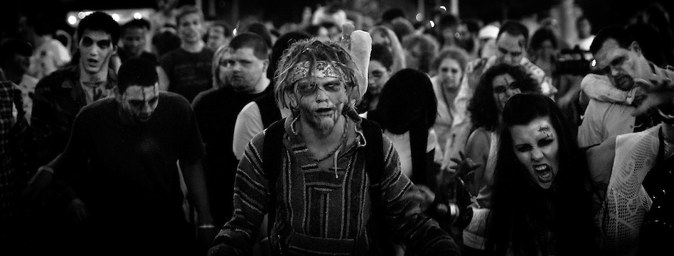 A horde of folks dressed as zombies zombies shuffle and moan their way through downtown Des Moines on Aug 26. (Christopher Gannon)